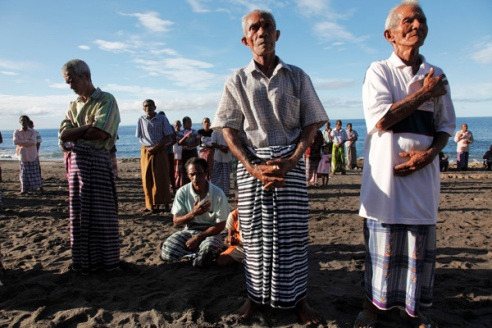 Local fishermen in their Sunday best stand during the ceremony of 'Misa Lefa', a ceremony held once a year to bless the fishing boats and bring luck to the upcoming season.