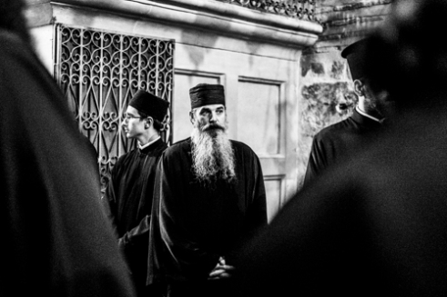 Priest in the church - Old City, Jerusalem