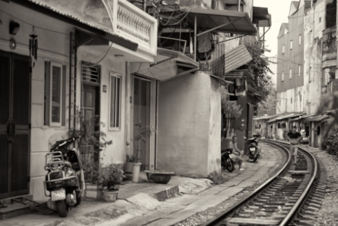 A railway line crosses the old quarter of Hanoi, close to homes and outdoor kitchen