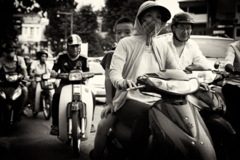 """Vietnam would not be the same without the motorcycles. Ho Chi Minh City is also called """"Honda City"""". The name also suits Hanoi. Here someone is always looking above a shoulder."""