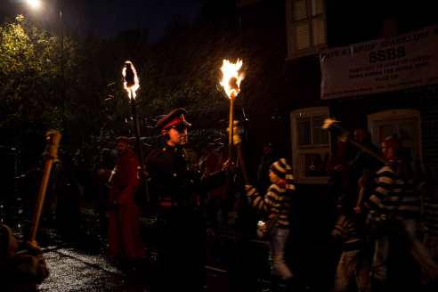 Torches are lit at the start of the South Street Bonfire Society's junior procession.