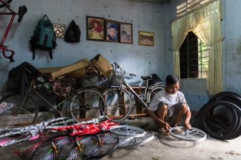 Truing a bicycle wheel Hue, Vietnam