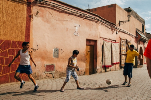 Kids playing in the street. Marrakech, Morocco