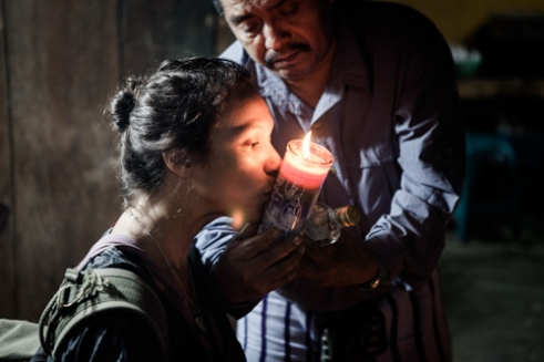 A Nicaraguan tourist taking a clean soul from a Shaman.