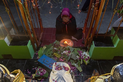 """KLATEN-INDONESIA, October 22 2015. One by one of villagers coming to the sacred place to praying and bring offerings such as various kinds of flowers where their holy ancestor named """"Mbok Roro Tanjungsari"""" and """"Mbok Roro Payung Gilap"""" praying to God at this place since 18th Century ago. Tanjungsari villager holds an annual tradition called """"Bersih Desa"""" to Commemorate 10th of Muharram (Islamic Calendar) as believed as a sacred day for Javanese Muslim people."""