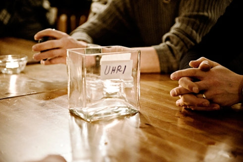 The glass jar on the table is labelled 'OFFERING'.