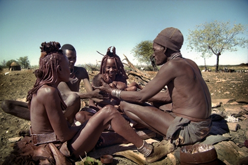 The Headman of Etanga holds Tjimbosi during his namegiving ceremony, with left, Omukurukaze, the Headman's wife, Ngavekupe, the father, and Kakaendona, themother and the Headman's youngest daughter. oHere, Kunene North Region, Namibia, 1998