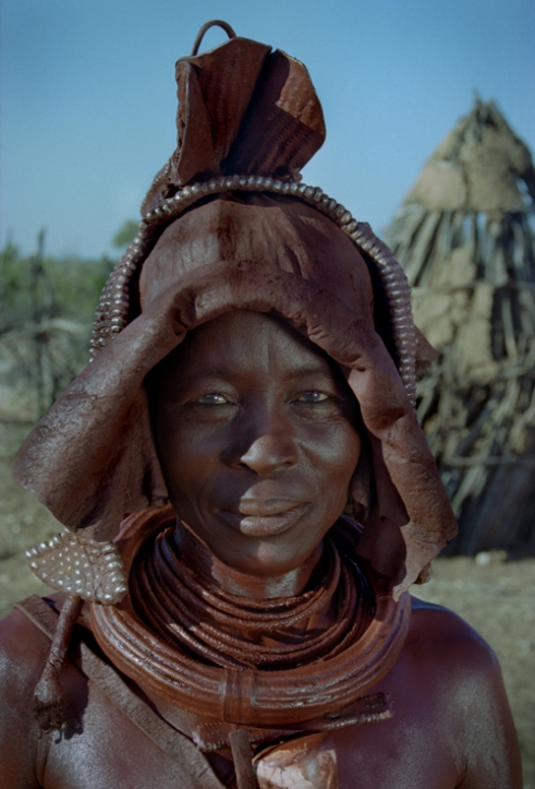 Katjekere's mother wearing a headdress traditionally worn by a woman for her marraige. Wakapawe, Kunene North Region, Namibia, 2000