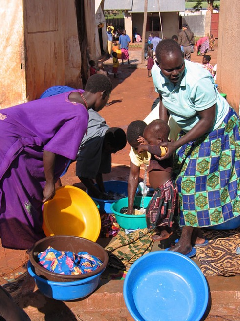Gulu, Uganda, 2004. Mothers, mostly teenagers wash dishes at GUSCO, the Gulu Support the Children Organization. GUSCO is a reception centre for people, again mostly teenagers, who manage to free themselves from their Lord's Resistance Army captors.