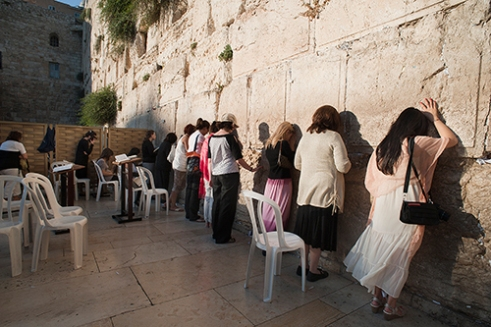 Young Jewish women praying at the Western Wall.