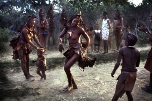Twakupasana and her friends plays a last Ondjongo dance in the dry riverbed on their way home. Etanga, Kunene North Region, Namibia, 2001