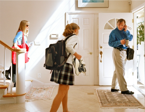John, San Carlos, California. Mother, daughter, and father rush out the door to work and school on a busy weekday morning.