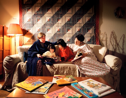 Lilian and Grace, Belmont, California. This lesbian couple has two adopted Chinese daughters, Lilian and Grace. Since the older girl is learning to read at school, their mothers have put signs around the house labeling everything. Reading books together before bed is a nightly treat.