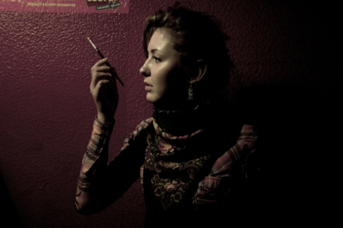Anna smoking a cigarette. In Leningrad clubs are still smokers friendly.