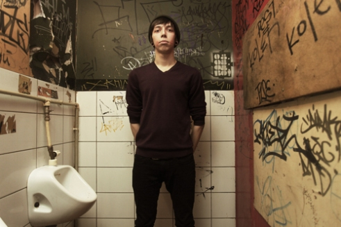 A guy photographed in the toilette of the Fidel, one of the clubs of the Dumskaya Ulitsa.