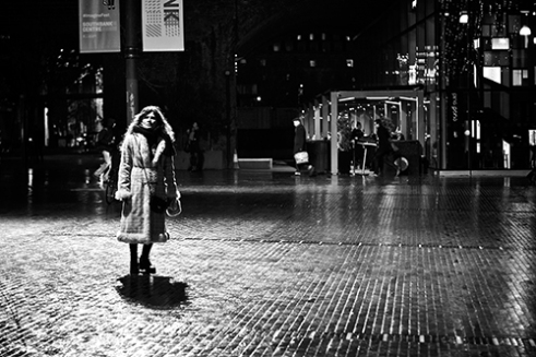 Alone in London in the rain on Upper Ground, London.