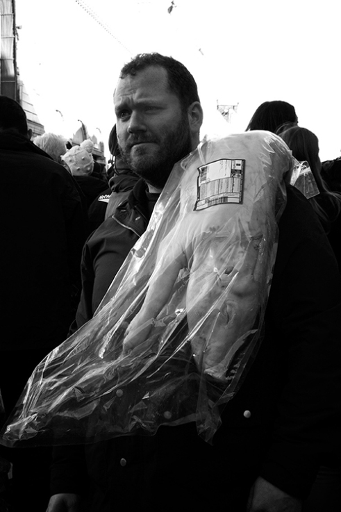 Punter with a suckling pig at the Christmas Eve meat auction, Smithfield Market, London.