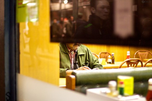 Soho Windows #4. Green and yellow in a corner cafe in Soho London.