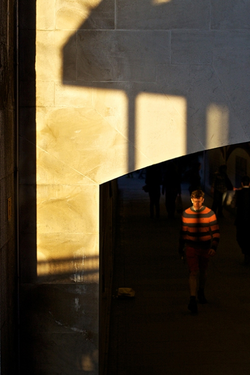 Caught by the shadows in a stripey top, Bankside, London.