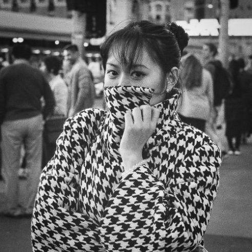 Girl in coat Federation Square, Melbourne, Australia.