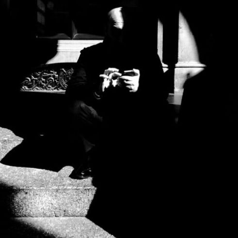 Man on phone Martin Place, Sydney, Australia.