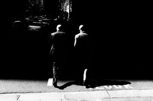 Two bald men walk into black CBD,  Sydney, Australia.