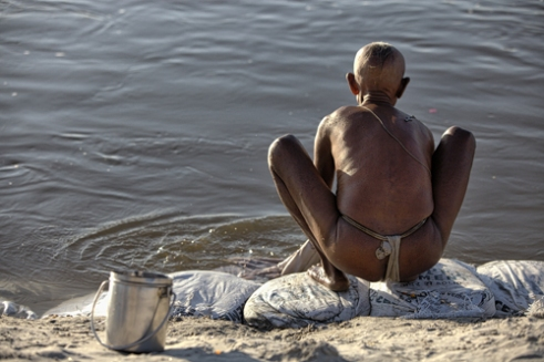 Pilgrim is ready for a ritual bath in sacred river Gange.