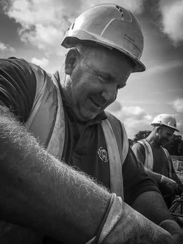 "Paul ""the unit"" – can be found as a smiling duo with his cousin Lee – something of a rare picture perhaps, but one that means a lot nevertheless – steelfixers do it with a smile. Dartford, UK"