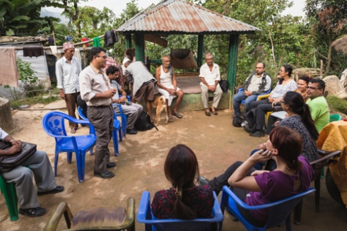 Non-profits Renewable World, iDE, Practical Action, and community farmers meet in Sirubari, rural Nepal to discuss the impact of solar energy for drinking water.