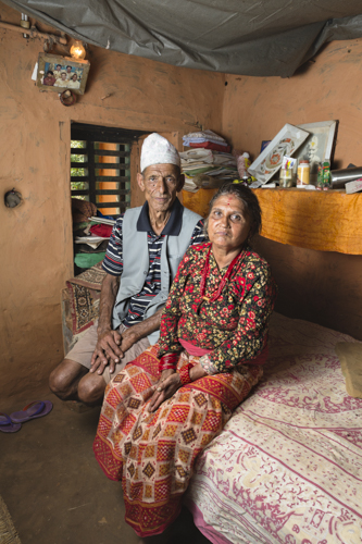 Dilli Ram Regmi and his wife Dil Mava Regmi inside the bedroom of their cracked housed in Sirubari, rural Nepal post April 25th earthquake that hit the country.