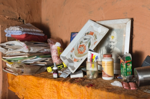 The belongings of Dilli Ram Regmi and his wife inside the bedroom of their cracked housed post earthquake in Sirubari, rural Nepal.