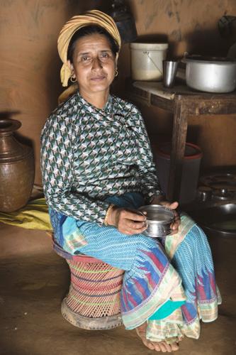 Farmer Maiya Regmi living and working in the farming community with Dilli Ram Regmi in Sirubari, rural Nepal