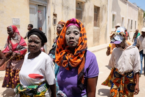 Most Makua, an ethnic group, support the Renamo party. The Makua hold tight to their traditional worship and their white facial mask.