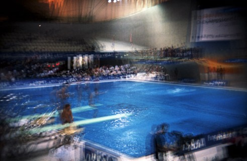 Athletes diving during the Practice Diving Event before the London Olympics. The London Aquatic Centre. Multiple exposure using a Holga camera.
