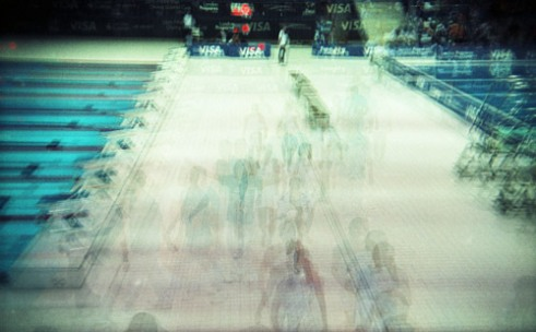Athletes prepare to dive during the Practice Diving Event before the London Olympics. The London Aquatic Centre. Multiple exposure using a Holga camera.