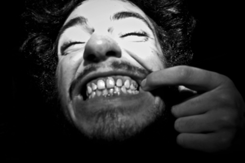 A man refuses to show me his wounds after coming out of a Mash Pit bloody, instead he decides to show me his teeth. Chicago's South Side Punk Shows. 2015