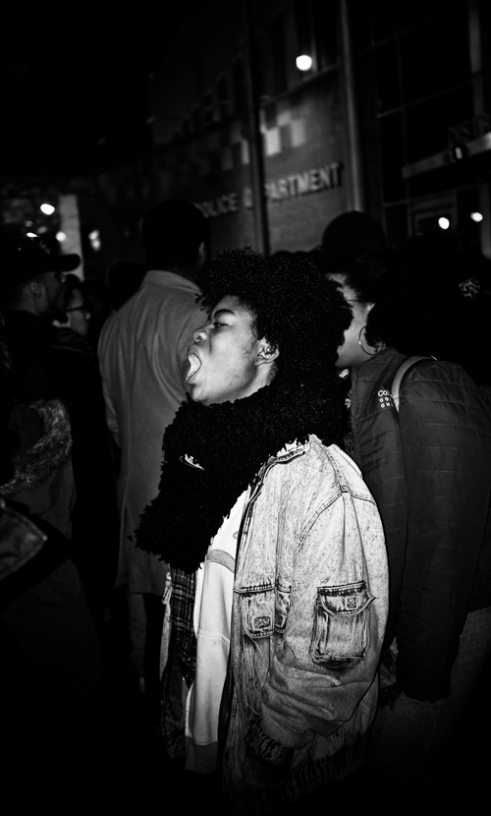 """A protester begins to rally up Laquan McDonald supporters chanting, """"They think it's a joke, and we aren't supposed to be mad"""", during the Laquan McDonald Protest. Chicago Police Department on 17th and State in Chicago, IL. November 24, 2015"""