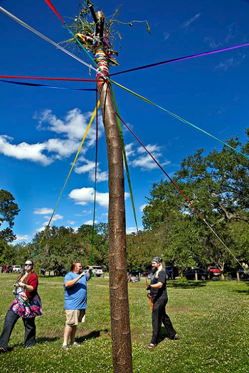 Maypole in Audubon Park SPRINGFIELD, LA. Pagens dance around the maypole celebrating fertility and planting seeds for a bountiful future harvest.