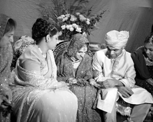 Safoorah Khan receiving her wedding ring from her new husband, Kamran, Charlotte, NC.