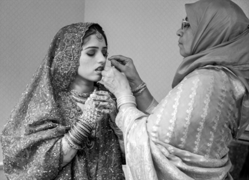 Safforah Khan dresses for her arranged marriage with the help of her aunt. Charlotte, NC.