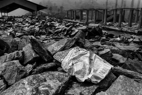 A book lies among the rubble of the school in Ghyachchok