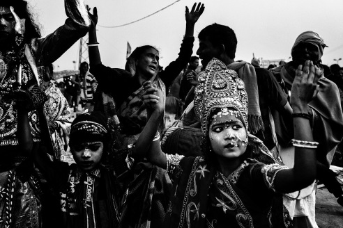 An young girl participate in the holy Ganga Sagar festival dressed up as a Goddess. She traveled 180 KM from hew village to attend this occasion and was told that this custom was more important than her annual exams which was due in 5 days time.