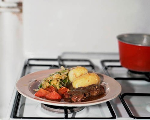 The every day meal of meat (usualy a lamb steak, pork chop or 1/4 pound Rump or Sirloin steak), boiled potatoes and Savoy Cabbage with gravy made from a mix of the fat from the meat and Bisto granules.