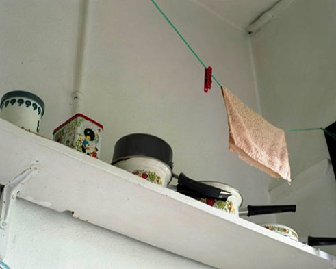"""Indoor drying line used on """"Washing Mondays"""" hanging over the kitchen sink."""