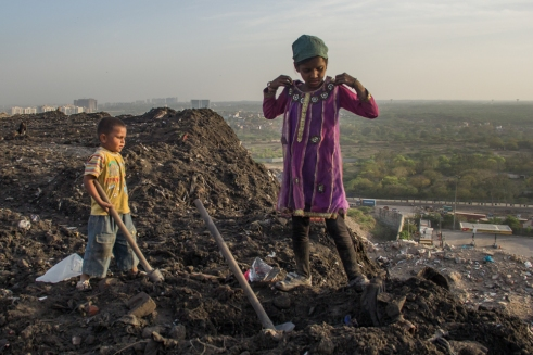 Children doing their share of work scavenging in Okhla Landfill - Delhi.