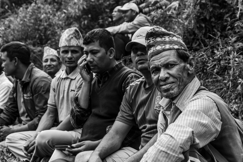 Nepalese men wearing the typical topi hat. (Bhachchek).