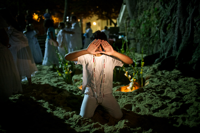 December 2011. Candomblé rituals on a beach in RIo de Janeiro - part of an hours-long gathering. Candomblé has it's roots in African religious culture.