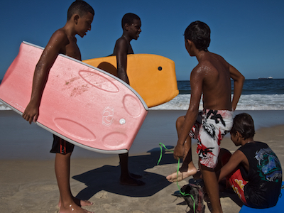 March 2011. A group of boys after body-surfing at Copacabana beach.
