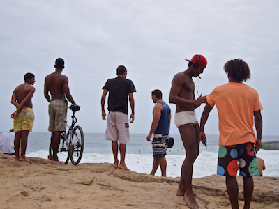 December 2011. A group of surfers gather at Apoador between Ipanema and Copacabana beaches in Rio de Janeiro.