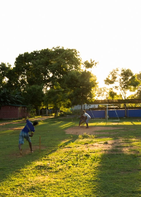 Cricket: a religion not a sport. The children play every day at 4pm until the suns robs them of the opportunity Vavuniya, Sri Lanka, 2015
